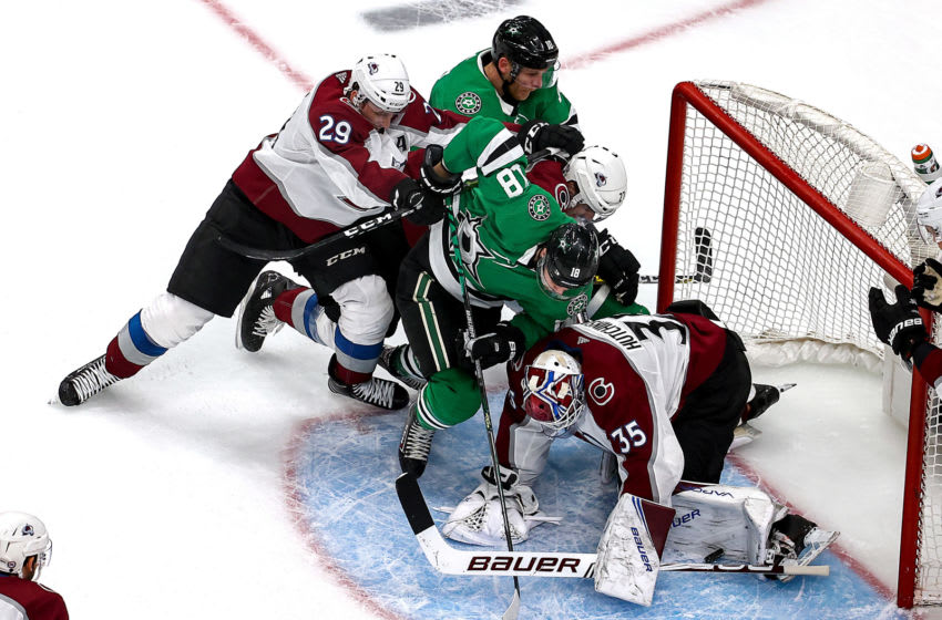 EDMONTON, ALBERTA - SEPTEMBER 02: Michael Hutchinson #35 of the Colorado Avalanche stops a shot against Jason Dickinson #18 and Corey Perry #10 of the Dallas Stars during the second period in Game Six of the Western Conference Second Round during the 2020 NHL Stanley Cup Playoffs at Rogers Place on September 02, 2020 in Edmonton, Alberta, Canada. (Photo by Bruce Bennett/Getty Images)