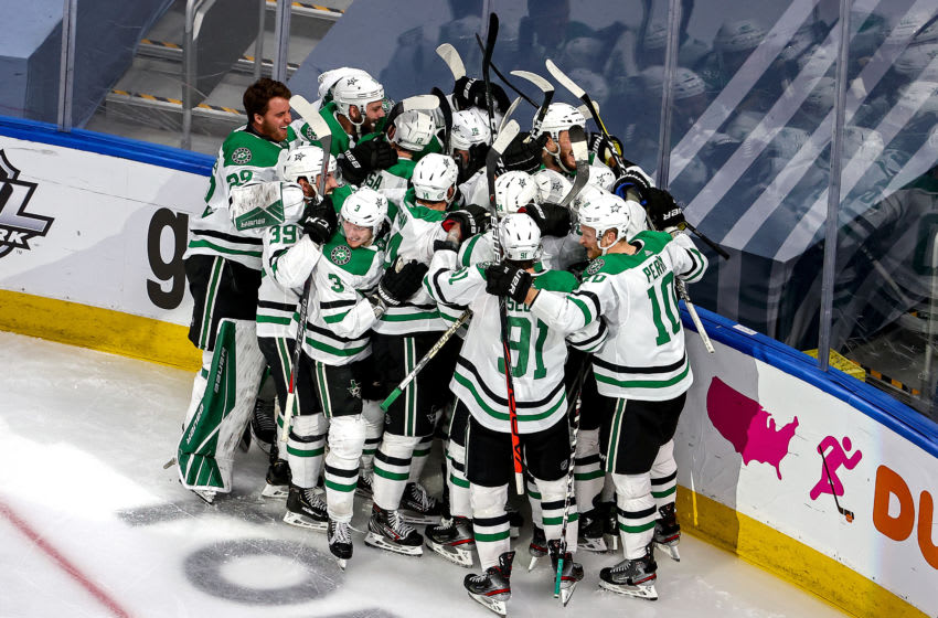 EDMONTON, ALBERTA - SEPTEMBER 04: Joel Kiviranta #25 of the Dallas Stars is congratulated by his teammates after scoring the game-winning goal against the Colorado Avalanche during the first overtime period to win Game Seven of the Western Conference Second Round during the 2020 NHL Stanley Cup Playoffs at Rogers Place on September 04, 2020 in Edmonton, Alberta, Canada. (Photo by Bruce Bennett/Getty Images)