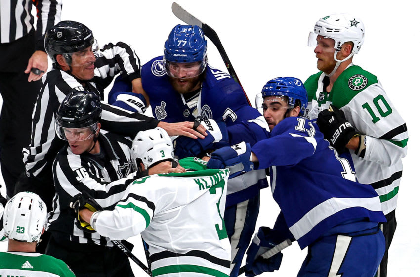 EDMONTON, ALBERTA - SEPTEMBER 21: Victor Hedman #77 and Cedric Paquette #13 of the Tampa Bay Lightning scuffle with John Klingberg #3 of the Dallas Stars during the second period in Game Two of the 2020 NHL Stanley Cup Final at Rogers Place on September 21, 2020 in Edmonton, Alberta, Canada. (Photo by Bruce Bennett/Getty Images)