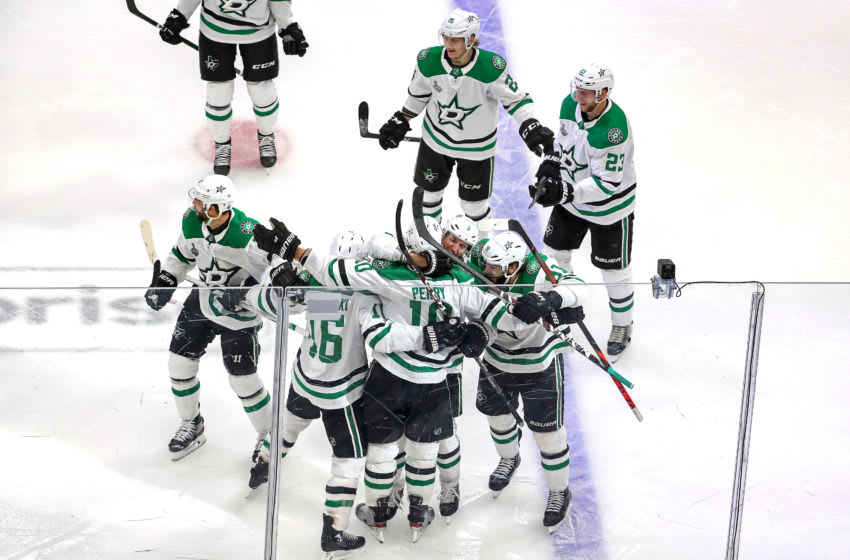 EDMONTON, ALBERTA - SEPTEMBER 26: Corey Perry #10 of the Dallas Stars is congratulated by his teammates after scoring the game-winning goal during the second overtime period against the Tampa Bay Lightning to give the Stars the 3-2 victory in Game Five of the 2020 NHL Stanley Cup Final at Rogers Place on September 26, 2020 in Edmonton, Alberta, Canada. (Photo by Bruce Bennett/Getty Images)
