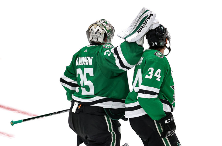 EDMONTON, ALBERTA - SEPTEMBER 28: Anton Khudobin #35 of the Dallas Stars taps Denis Gurianov #34 on the head after Gurianov blocks a shot against the Tampa Bay Lightning during the third period in Game Six of the 2020 NHL Stanley Cup Final at Rogers Place on September 28, 2020 in Edmonton, Alberta, Canada. (Photo by Bruce Bennett/Getty Images)