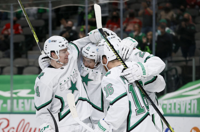 DALLAS, TEXAS - APRIL 19: Jason Robertson #21 of the Dallas Stars celebrates with Miro Heiskanen #4 of the Dallas Stars, Jamie Oleksiak #2 of the Dallas Stars and Joe Pavelski #16 of the Dallas Stars after scoring a goal against the Detroit Red Wings in the second period at American Airlines Center on April 19, 2021 in Dallas, Texas. (Photo by Tom Pennington/Getty Images)