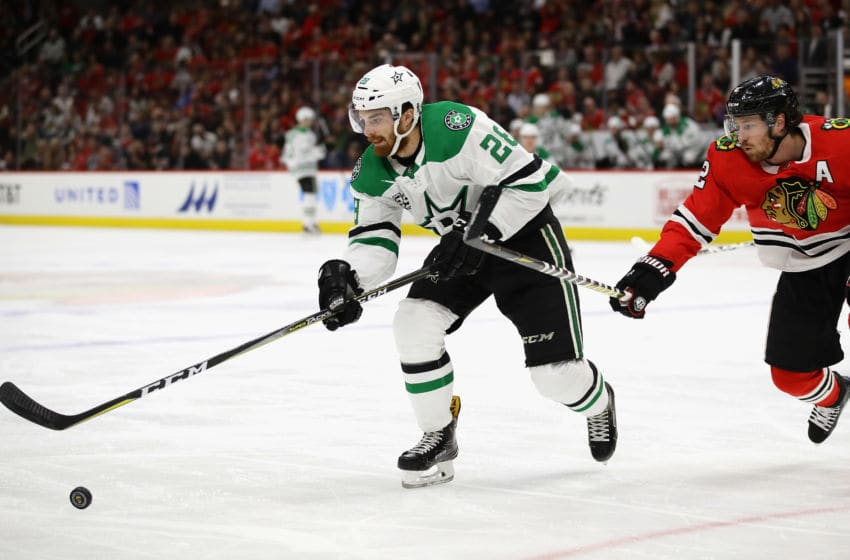 CHICAGO, IL - FEBRUARY 08: Stephen Johns #28 of the Dallas Stars and Duncan Keith #2 of the Chicago Blackhawks chase the puck at the United Center on February 8 2018 in Chicago, Illinois. (Photo by Jonathan Daniel/Getty Images)