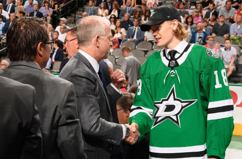 DALLAS, TX - JUNE 23: Albin Eriksson shakes the hand of general manager Jim Nill of the Dallas Stars after being selected 44th overall by the Dallas Stars during the 2018 NHL Draft at American Airlines Center on June 23, 2018 in Dallas, Texas. (Photo by Brian Babineau/NHLI via Getty Images)