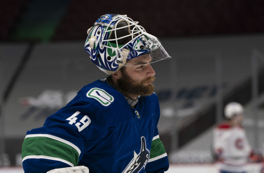 VANCOUVER, BC - JANUARY 20: Goalie Braden Holtby #49 of the Vancouver Canucks during NHL hockey action against the Montreal Canadiens at Rogers Arena on January 20, 2021 in Vancouver, Canada. (Photo by Rich Lam/Getty Images)