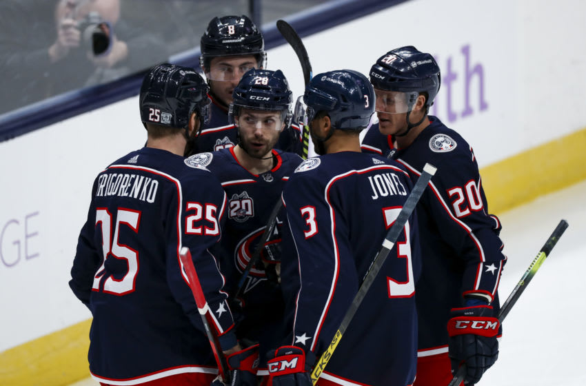 Feb 4, 2021; Columbus, Ohio, USA; Columbus Blue Jackets right wing Oliver Bjorkstrand (middle) celebrates with teammates after scoring a goal against the Dallas Stars in the first period at Nationwide Arena. Mandatory Credit: Aaron Doster-USA TODAY Sports