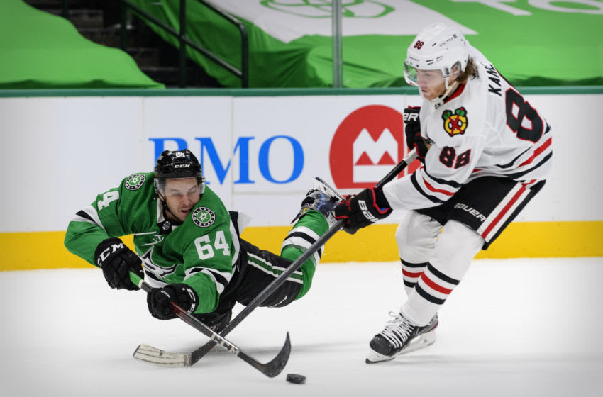 Feb 9, 2021; Dallas, Texas, USA; Dallas Stars center Tanner Kero (64) knocks the puck away from Chicago Blackhawks right wing Patrick Kane (88) during the second period at the American Airlines Center. Mandatory Credit: Jerome Miron-USA TODAY Sports