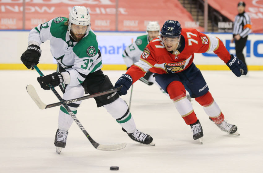 Feb 24, 2021; Sunrise, Florida, USA; Dallas Stars center Justin Dowling (37) protects the puck from Florida Panthers center Frank Vatrano (77) during the second period at BB&T Center. Mandatory Credit: Sam Navarro-USA TODAY Sports