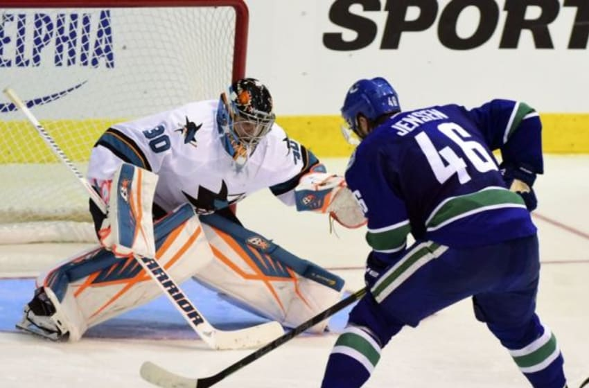 Sep 21, 2015; Victoria, British Columbia, CAN; Vancouver Canucks forward Nicklas Jensen (46) moves the puck against San Jose Sharks goaltender Aaron Dell (30) during the third period at Q Centre. The Vancouver Canucks won 1-0 in overtime. Mandatory Credit: Anne-Marie Sorvin-USA TODAY Sports