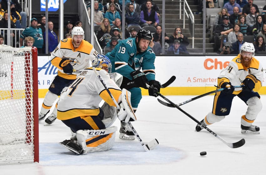 SAN JOSE, CA - NOVEMBER 13: Joe Thornton #19 (Center) of the San Jose Sharks moves the puck on net against Juuse Saros #74 and Ryan Ellis #4 of the Nashville Predators at SAP Center on November 13, 2018 in San Jose, California (Photo by Brandon Magnus/NHLI via Getty Images)