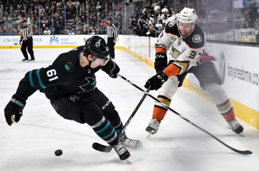 SAN JOSE, CA - DECEMBER 27: Nick Ritchie #37 of the Anaheim Ducks skates with the puck against Justin Braun #61 at SAP Center on December 27 2018 in San Jose, California (Photo by Brandon Magnus/NHLI via Getty Images)