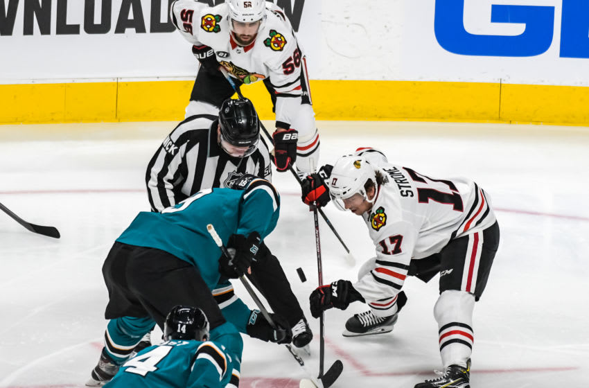SAN JOSE, CA - MARCH 03: San Jose Sharks Center Joe Thornton (19) and Chicago Blackhawks Center Dylan Strome (17) face off during the game between the Chicago Blackhawks and the San Jose Sharks on Sunday, March 3, 2019 at the SAP Center in San Jose, California. (Photo by Douglas Stringer/Icon Sportswire via Getty Images)