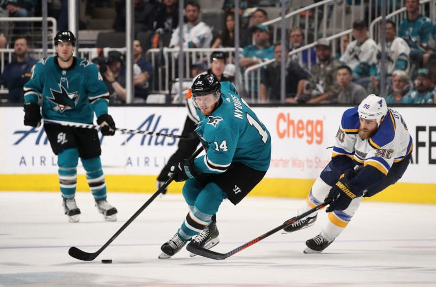 SAN JOSE, CALIFORNIA - MAY 11: Gustav Nyquist #14 of the San Jose Sharks skates with the puck ahead Ryan O'Reilly #90 of the St. Louis Blues in Game One NHL Western Conference Final during the 2019 NHL Stanley Cup Playoffs at SAP Center on May 11, 2019 in San Jose, California. The Sharks defeated the Blues 6-3. (Photo by Christian Petersen/Getty Images)
