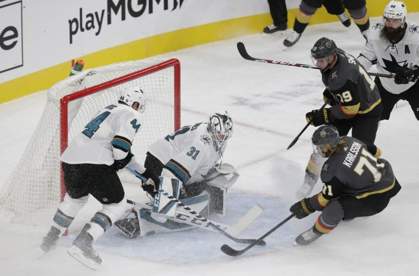 LAS VEGAS, NV - OCTOBER 02: San Jose Sharks goaltender Martin Jones (31) blocks a shot from Vegas Golden Knights center William Karlsson (71) during a regular season game Wednesday, Oct. 2, 2019, at T-Mobile Arena in Las Vegas, Nevada. (Photo by: Marc Sanchez/Icon Sportswire via Getty Images)