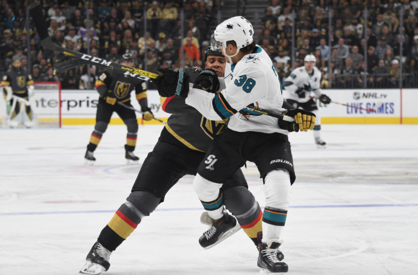 LAS VEGAS, NEVADA - OCTOBER 02: Ryan Reaves #75 of the Vegas Golden Knights hits Mario Ferraro #38 of the San Jose Sharks during the first period at T-Mobile Arena on October 02, 2019 in Las Vegas, Nevada. (Photo by David Becker/NHLI via Getty Images)