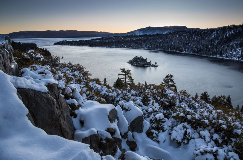 SOUTH LAKE TAHOE, CA - MARCH 3: A light coating of snow dusts the mountains around Emerald Bay following a fast-moving storm the day before as viewed on March 3, 2020, in South Lake Tahoe, California. After a series of heavy snowstorms in December, the moisture flowing off the Pacific Ocean and into the mountains disappeared in January and February leaving the annual snowpack at 50 percent of normal. (Photo by George Rose/Getty Images)