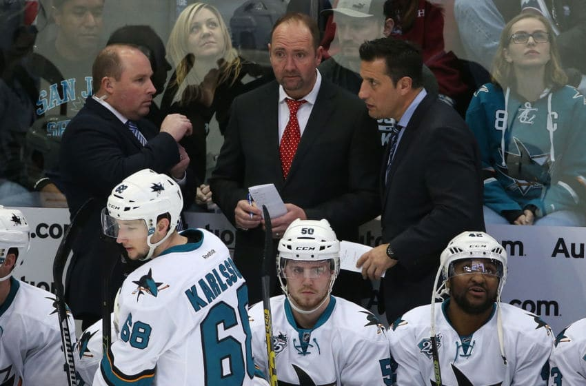 DENVER, CO - FEBRUARY 24: (L-R) Assistant coach Steve Spott, head coach Peter DeBoer and assistant coach Bob Boughner of the San Jose Sharks talk during a break in the action against the Colorado Avalanche at Pepsi Center on February 24, 2016 in Denver, Colorado. The Avalanche defeated the Sharks 4-3 in an overtime shoot out. (Photo by Doug Pensinger/Getty Images)