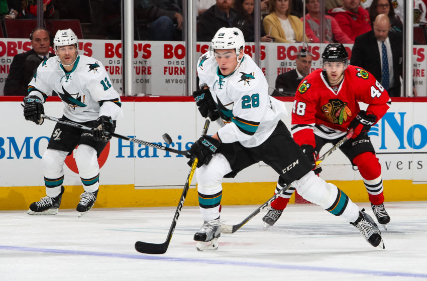 CHICAGO, IL - DECEMBER 18: Timo Meier #28 of the San Jose Sharks approaches the puck, as Patrick Marleau #12 and Vinnie Hinostroza #48 of the Chicago Blackhawks watch from behind, in the first period at the United Center on December 18, 2016 in Chicago, Illinois. (Photo by Chase Agnello-Dean/NHLI via Getty Images)