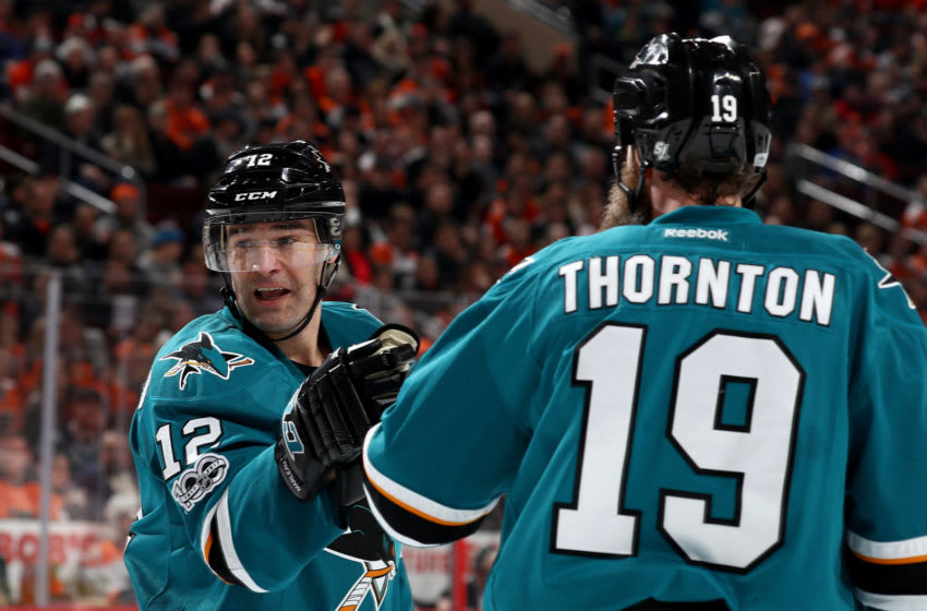 PHILADELPHIA, PA - FEBRUARY 11: Patrick Marleau #12 of the San Jose Sharks is congratulated by teammate Joe Thornton #19 after he scored in the third period against the Philadelphia Flyers on February 11, 2017 at Wells Fargo Center in Philadelphia, Pennsylvania.The Philadelphia Flyers defeated the San Jose Sharks 2-1 in overtime. (Photo by Elsa/Getty Images)
