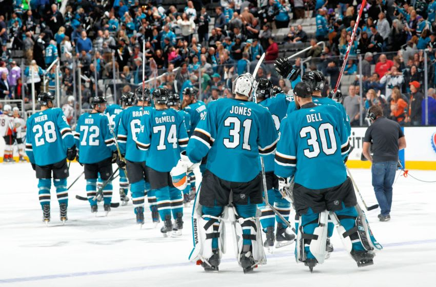 SAN JOSE, CA - NOVEMBER 4: Martin Jones #31 and Aaron Dell #30 of the San Jose Sharks skate away as the Sharks celebrate their win against the Anaheim Ducks at SAP Center on November 4, 2017 in San Jose, California. The Sharks defeated the Ducks 2-1 in a shootout. (Photo by Scott Dinn/NHLI via Getty Images)