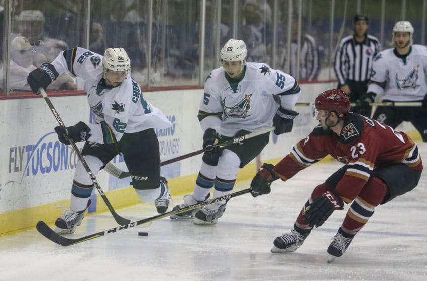 TUCSON, AZ - APRIL 27: San Jose Barracuda left wing Ivan Chekhovich (82) tries to get the puck past Tucson Roadrunners defenseman Kyle Capobianco (23) during a hockey game between the Chicago Wolves and Tuscon Roadrunners on April 27, 2018, at Tucson Convention Center in Tucson, AZ. (Photo by Jacob Snow/Icon Sportswire via Getty Images)