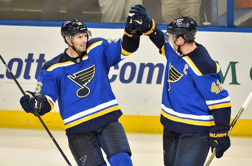 Oct 8, 2015; St. Louis, MO, USA; St. Louis Blues right wing Troy Brouwer (L) celebrates with center David Backes (R) after scoring an empty net goal against the Edmonton Oilers during the third period at Scottrade Center. Mandatory Credit: Jasen Vinlove-USA TODAY Sports
