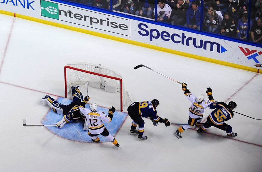 Dec 30, 2016; St. Louis, MO, USA; Nashville Predators left wing Viktor Arvidsson (38) celebrates with center Mike Fisher (12) after scoring against St. Louis Blues goalie Jake Allen (34) defenseman Jay Bouwmeester (19) and defenseman Colton Parayko (55) during the second period at Scottrade Center. Mandatory Credit: Jeff Curry-USA TODAY Sports