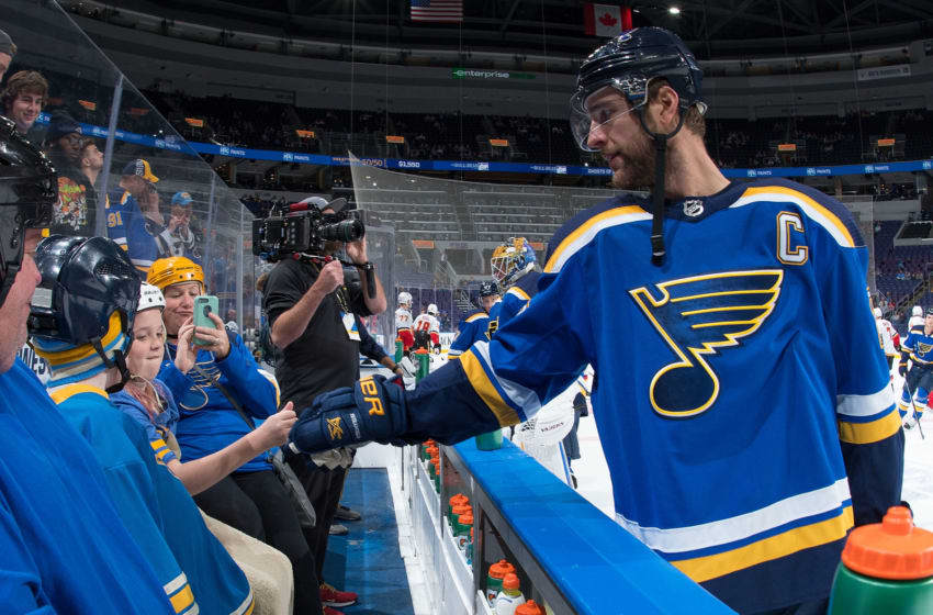 ST. LOUIS, MO - OCTOBER 11: Alex Pietrangelo #27 of the St. Louis Blues greets a fan during warmups before the game against the Calgary Flames at Enterprise Center on October 11, 2018 in St. Louis, Missouri. (Photo by Scott Rovak/NHLI via Getty Images)