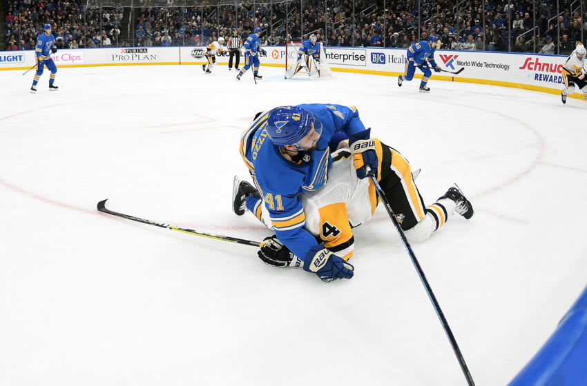 ST. LOUIS, MO. - DECEMBER 29: St. Louis Blues defenseman Robert Bortuzzo (41) falls over Pittsburgh Penguins leftwing Tanner Pearson (14) during an NHL game between the Pittsburgh Penguins and the St. Louis Blues on December 29, 2018, at Enterprise Center, St. Louis, MO. (Photo by Keith Gillett/Icon Sportswire via Getty Images)