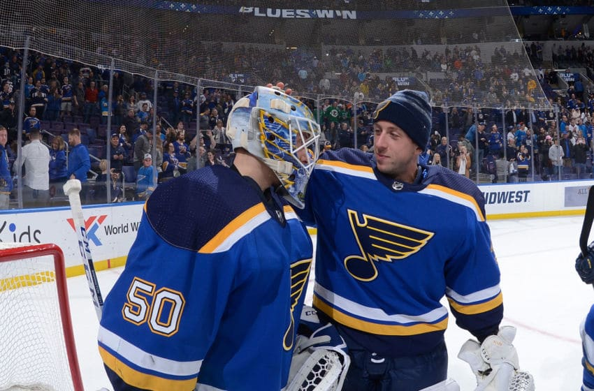 ST. LOUIS, MO - MARCH 19: Jordan Binnington #50 of the St. Louis Blues is congratulated by Jake Allen #34 of the St. Louis Blues after beating the Edmonton Oilers 7-2 at Enterprise Center on March 19, 2019 in St. Louis, Missouri. (Photo by Joe Puetz/NHLI via Getty Images)
