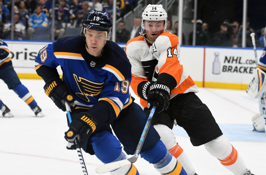 ST. LOUIS, MO - APRIL 04: St. Louis Blues defenseman Jay Bouwmeester (19) and Philadelphia Flyers center Sean Couturier (14) compete for the puck during a NHL game between the Philadelphia Flyers and the St. Louis Blues on April 04, 2019, at Enterprise Center, St. Louis, Mo. (Photo by Keith Gillett/Icon Sportswire via Getty Images)