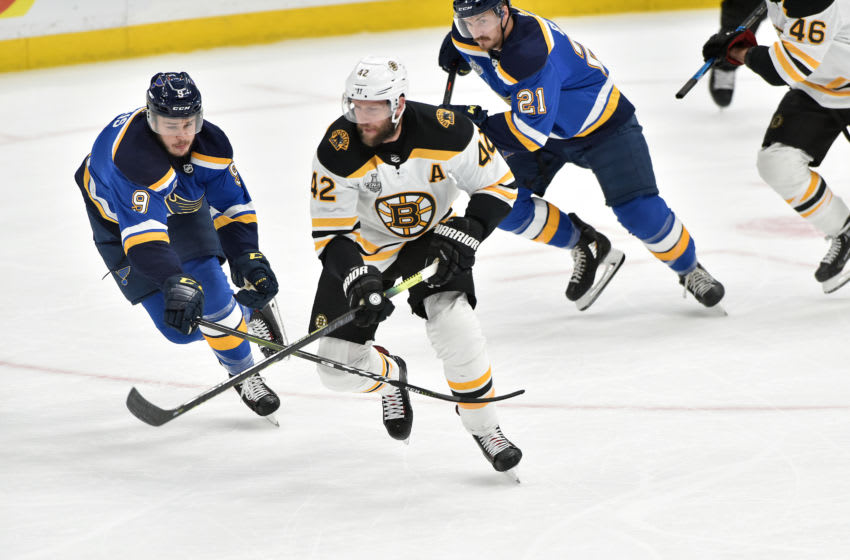 ST. LOUIS, MO - JUN 03: St. Louis Blues leftwing Sammy Blais (9) and Boston Bruins rightwing David Backes (42) skate after a loose puck during Game 4 of the Stanley Cup Final between the Boston Bruins and the St. Louis Blues, on June 01, 2019, at Enterprise Center, St. Louis, Mo. (Photo by Keith Gillett/Icon Sportswire via Getty Images)