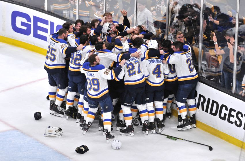 BOSTON, MA - JUNE 12: St. Louis Blues players celebrate their first Stanley Cup title in franchise history. During Game 7 of the Stanley Cup Finals featuring the St. Louis Blues against the Boston Bruins on June 12, 2019 at TD Garden in Boston, MA. (Photo by Michael Tureski/Icon Sportswire via Getty Images)