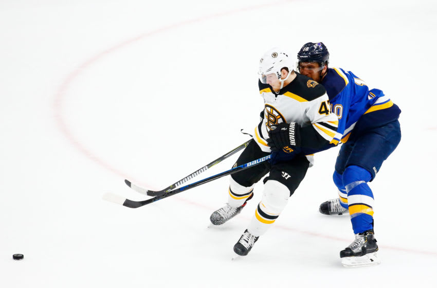 ST LOUIS, MISSOURI - JUNE 03: Brayden Schenn #10 of the St. Louis Blues and Torey Krug #47 of the Boston Bruins battle for the puck in Game Four of the 2019 NHL Stanley Cup Final at Enterprise Center on June 03, 2019 in St Louis, Missouri. (Photo by Dilip Vishwanat/Getty Images)