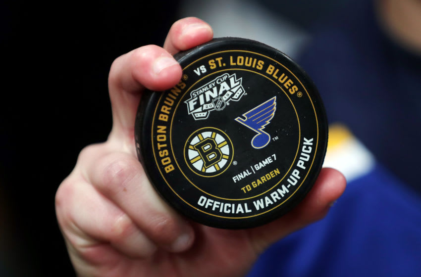 BOSTON, MASSACHUSETTS - JUNE 12: A fan holds an official warm-up puck prior to Game Seven of the 2019 NHL Stanley Cup Final between the Boston Bruins and the St. Louis Blues at TD Garden on June 12, 2019 in Boston, Massachusetts. (Photo by Adam Glanzman/Getty Images)