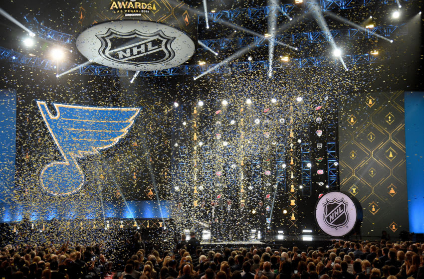 LAS VEGAS, NEVADA - JUNE 19: (L-R) Executive Vice President, Chief Financial & Administrative Officer Phil Siddle, goaltender Jordan Binnington, head coach Craig Berube, center Ryan O'Reilly, general manager Doug Armstrong and Chairman and Governor Tom Stillman of the St. Louis Blues display the Stanley Cup onstage during the 2019 NHL Awards at the Mandalay Bay Events Center on June 19, 2019 in Las Vegas, Nevada. (Photo by Ethan Miller/Getty Images)