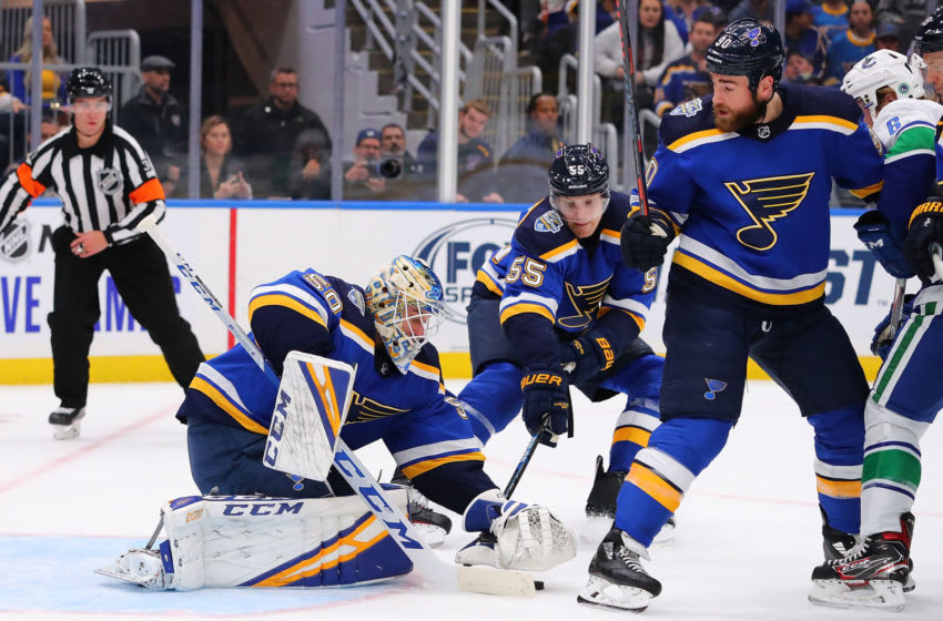 ST LOUIS, MO - OCTOBER 17: Jordan Binnington #50, Ryan OReilly #90 and Colton Parayko #55 of the St. Louis Blues defend the goal against the Vancouver Canucks at Enterprise Center on October 17, 2019 in St Louis, Missouri. (Photo by Dilip Vishwanat/Getty Images)