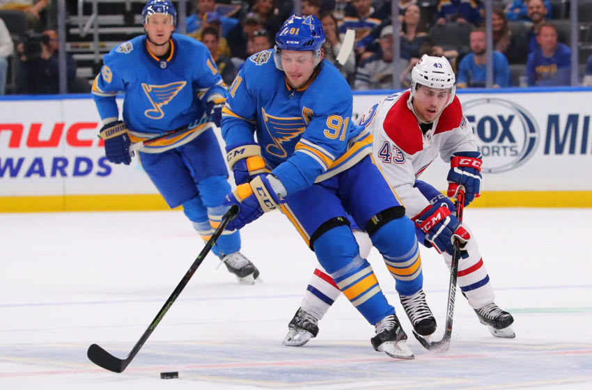 ST LOUIS, MO - OCTOBER 19: Vladimir Tarasenko #91 of the St. Louis Blues moves the puck up ice against Jordan Weal #43 of the Montreal Canadiens at Enterprise Center on October 19, 2019 in St Louis, Missouri. (Photo by Dilip Vishwanat/Getty Images)