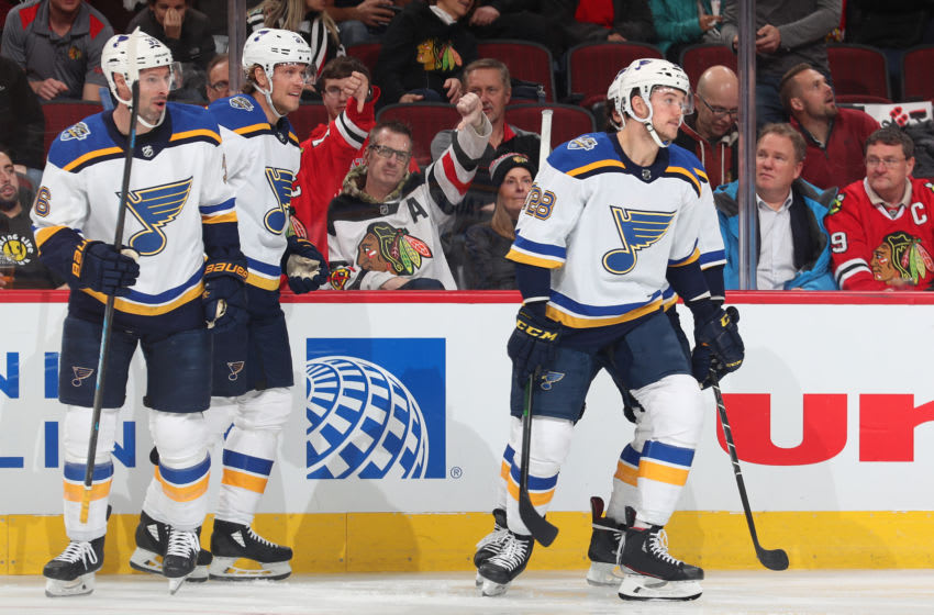 CHICAGO, IL - DECEMBER 02: Mackenzie MacEachern #28 of the St. Louis Blues skates away from teammates after celebrating a goal against the Chicago Blackhawks in the first period at the United Center on December 2, 2019 in Chicago, Illinois. (Photo by Chase Agnello-Dean/NHLI via Getty Images)