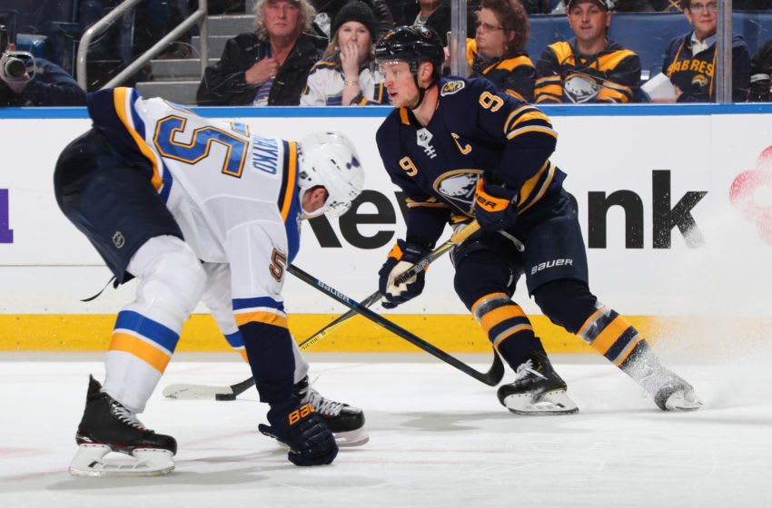 BUFFALO, NY - DECEMBER 10: Jack Eichel #9 of the Buffalo Sabres controls the puck against Colton Parayko #55 of the St. Louis Blues during an NHL game on December 10, 2019 at KeyBank Center in Buffalo, New York. Buffalo won, 5-2. (Photo by Bill Wippert/NHLI via Getty Images)