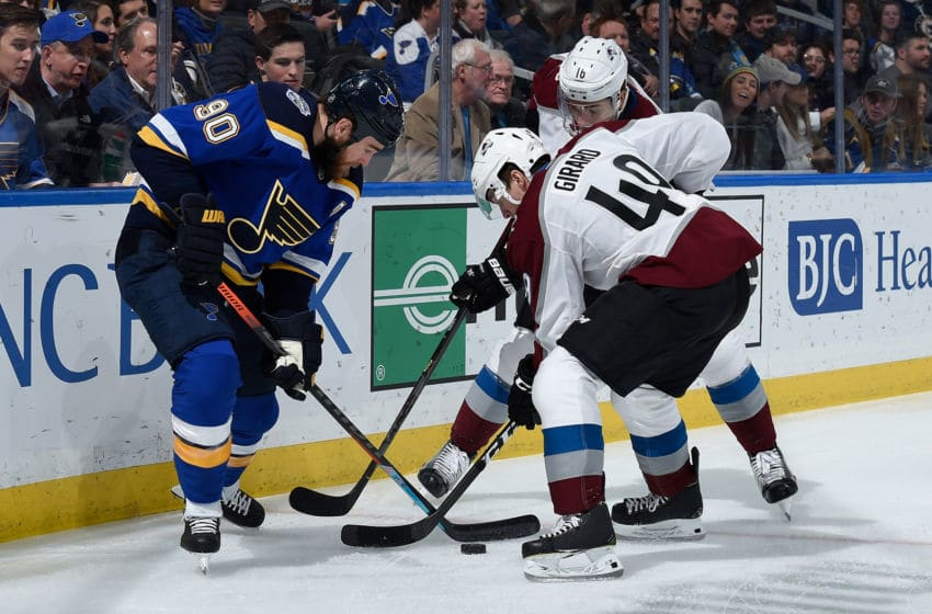 ST. LOUIS, MO - DECEMBER 16: Ryan O'Reilly #90 of the St. Louis Blues battles Samuel Girard #49 of the Colorado Avalanche for the puck at Enterprise Center on December 16, 2019 in St. Louis, Missouri. (Photo by Joe Puetz/NHLI via Getty Images)