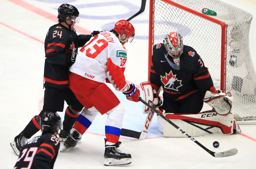 OSTRAVA, CZECH REPUBLIC - JANUARY 5, 2020: Canada's Nolan Foote (L front), Ty Smith (L back), goaltender Joel Hofer (R), and Russia's Yegor Sokolov (C) in the 2020 World Junior Ice Hockey Championship final match between Canada and Russia at Ostravar Arena. Peter Kovalev/TASS (Photo by Peter KovalevTASS via Getty Images)