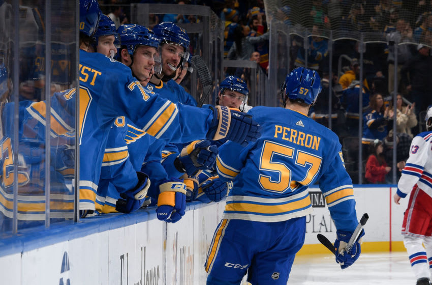ST. LOUIS, MO - JANUARY 11: David Perron #57 of the St. Louis Blues is congratulated after scoring a goal against the New York Rangers at Enterprise Center on January 11, 2020 in St. Louis, Missouri. (Photo by Scott Rovak/NHLI via Getty Images)