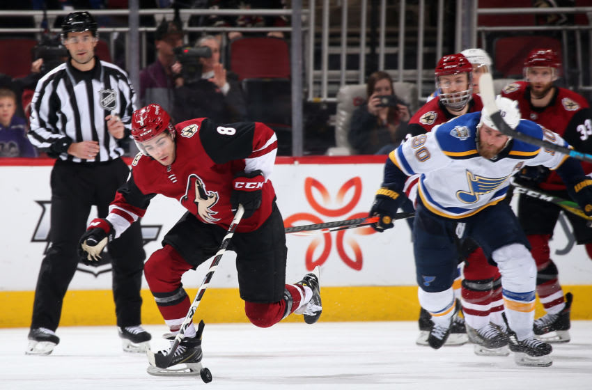 GLENDALE, ARIZONA - DECEMBER 31: Nick Schmaltz #8 of the Arizona Coyotes skates with the puck ahead of Ryan O'Reilly #90 of the St. Louis Blues during the third period of the NHL game at Gila River Arena on December 31, 2019 in Glendale, Arizona. The Coyotes defeated the Blues 3-1. (Photo by Christian Petersen/Getty Images)