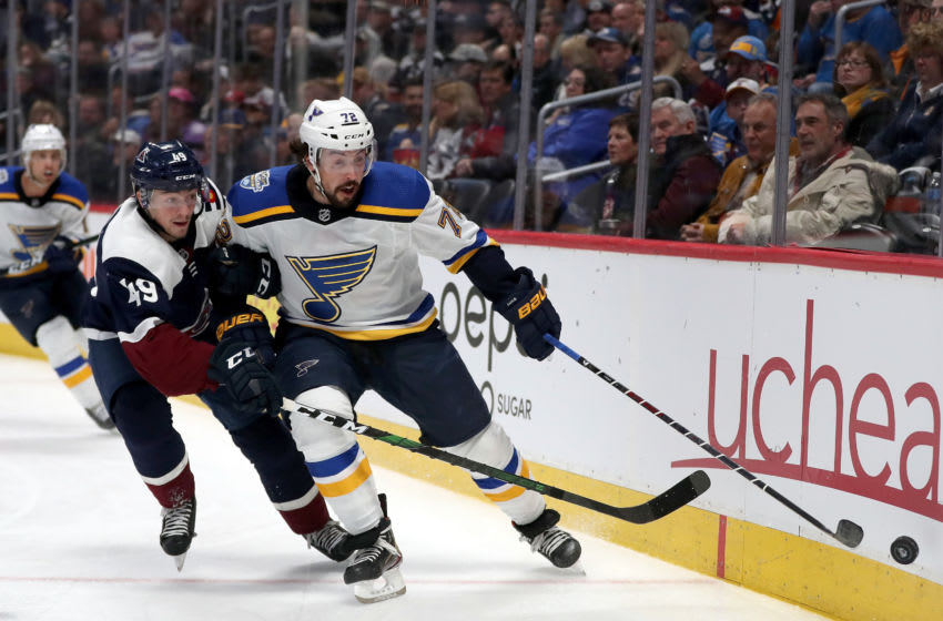 DENVER, COLORADO - JANUARY 02: Samuel Girard #49 of the Colorado Avalanche fights for the puck against Justin Faulk #72 of the St Louis Blues in the third period at the Pepsi Center on January 02, 2020 in Denver, Colorado. (Photo by Matthew Stockman/Getty Images)
