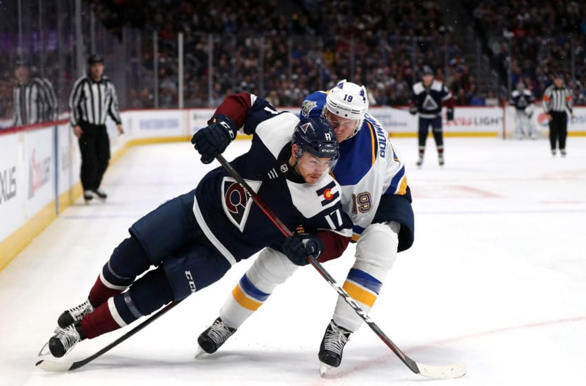 DENVER, COLORADO - JANUARY 02: Tyson Joist #17 of the Colorado Avalanche is tripped by Jay Bouwmeester #19 of the St Louis Blues in the second period at the Pepsi Center on January 02, 2020 in Denver, Colorado. (Photo by Matthew Stockman/Getty Images)