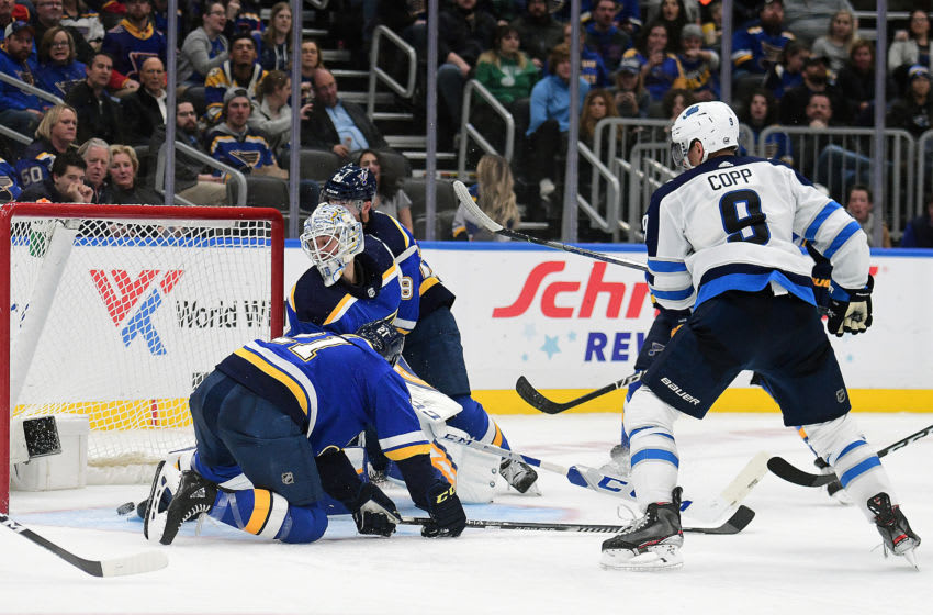 ST. LOUIS, MO- FEBRUARY 06: Winnipeg Jets center Andrew Copp (9) scores the winning goal during an NHL game between the Winnipeg Jets and the St. Louis Blues, on February 06, 2020, at Enterprise Center, St. Louis, MO. Photo by Keith Gillett/Icon Sportswire via Getty Images)