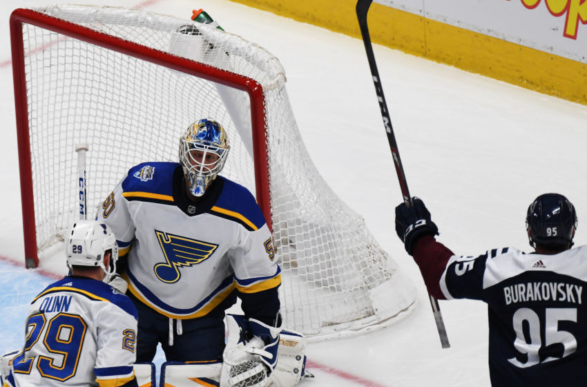 DENVER, CO - JANUARY 18: Colorado Avalanche Andre Burakovsky (95), right, scored the goal from St. Louis Blues goaltender Jordan Binnington (50) during the 2nd period of the game at Pepsi Center. Denver, Colorado. January 18, 2020. Colorado won 5-3. (Photo by Hyoung Chang/MediaNews Group/The Denver Post via Getty Images)