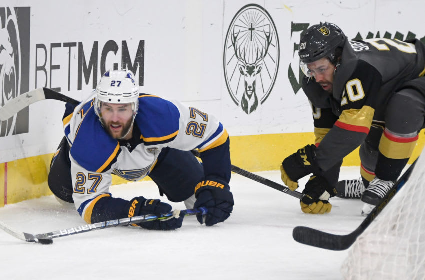 LAS VEGAS, NEVADA - FEBRUARY 13: Alex Pietrangelo #27 of the St. Louis Blues and Chandler Stephenson #20 of the Vegas Golden Knights go after the puck in the second period of their game at T-Mobile Arena on February 13, 2020 in Las Vegas, Nevada. The Golden Knights defeated the Blues 6-5 in overtime. (Photo by Ethan Miller/Getty Images)