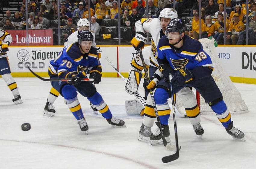 NASHVILLE, TENNESSEE - FEBRUARY 16: Oskar Sundqvist #70 and Ivan Barbashev #49 of the St. Louis Blues watch the puck bounce against the Nashville Predators during the second period at Bridgestone Arena on February 16, 2020 in Nashville, Tennessee. (Photo by Frederick Breedon/Getty Images)